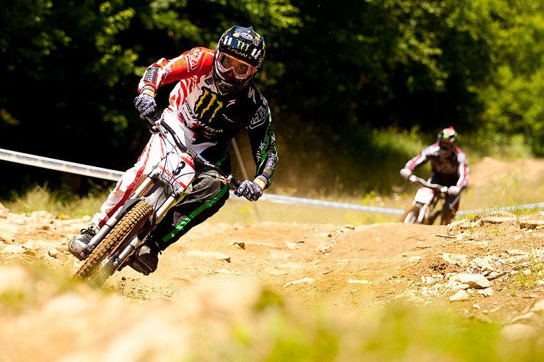 Sam Hill ripping with Shaun Palmer in tow.