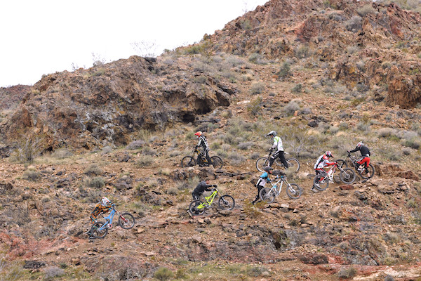 Riders hiking up for a practice run