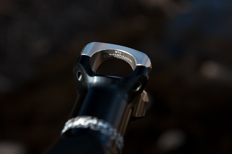 Top Lock Technology is pretty simple in application, and the arrow makes it easy to know which side is up when mounting the stem face plate. The real value gained is from eliminating unequal stress points on the bar which can lead to handlebar failure.